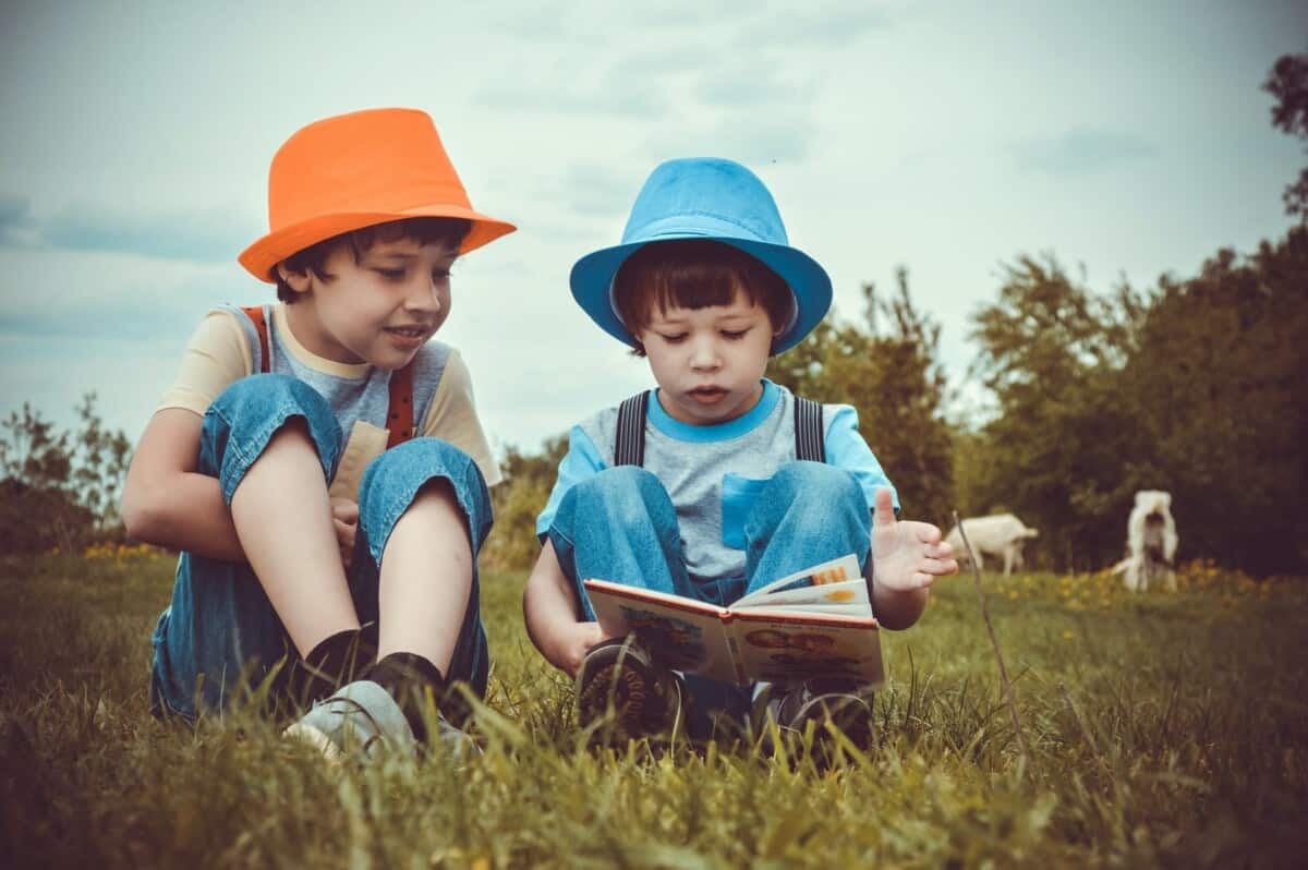 two boys reading aesop fables