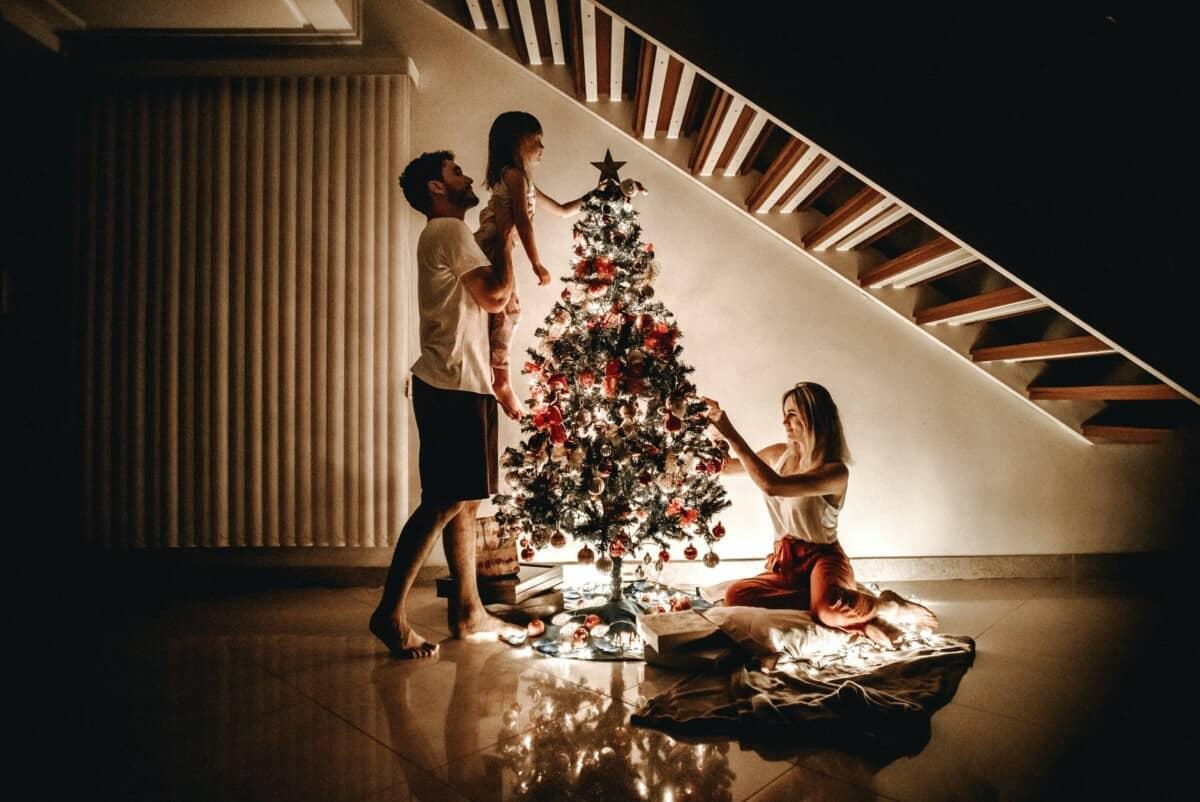 family arranging christmas tree