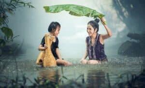 two girls under the rain